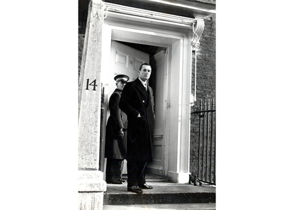Hardy Amies on the steps of No. 14 Savile Row: 1950