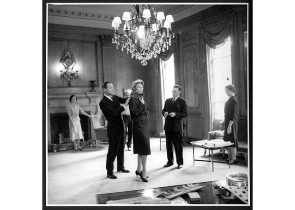 Hardy Amies fitting a model in the Grand Salon: 1955